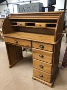 Pine bureau with tambour front and five drawers under