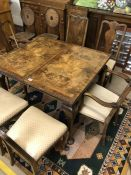 Extending dining table with six chairs (two carvers), table approx 106cm long unextended and 152cm