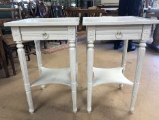 Pair of white painted occasional tables with tapered legs, single drawers and shelf under, each