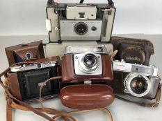 Collection of four vintage cameras to include Polaroid 103 Land Camera, Baldix Balda, Minolta Hi-