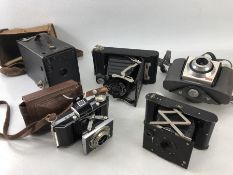 Collection of five vintage Kodak cameras to include: Eastman Rochester, New York vest pocket