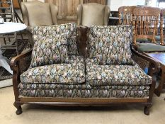 Early 20th Century cane-backed two seater Bergere sofa with upholstered cushions
