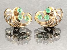 Pair of 9ct gold hallmarked earrings set with green stones (total weight 2.2g)