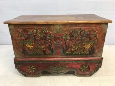 Large Eastern-style chest with heavily carved hand-painted scenes, brass detailing and cast iron