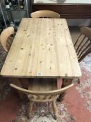 Pine kitchen table and four slat-back chairs, table approx 122cm x 77cm x 77cm tall
