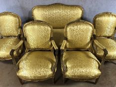 Five piece suite to include two seater sofa and four armchairs with wood and gilt frames and gold