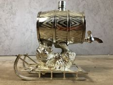Silver plated drinks barrel on a recumbent bear on a toboggan, approx 20cm in height