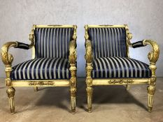 Pair of large empire blue upholstered chairs with gilt frames