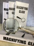 Set of four large magnifying glasses, approx 26cm in length