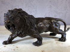 Bronze figure of a lion, approx 15cm in height