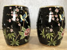 Pair of black porcelain barrel seats / stools, approx 46cm in height