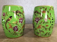 Pair of green porcelain barrel seats / stools with floral and bird design, approx 45cm in height