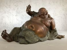 Large figure of a laughing Buddha, approx 37cm in height