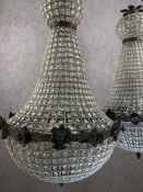 Pair of ballroom style chandeliers with beaded design, approx drop 95cm