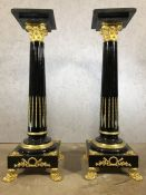 Pair of large black marble and gilt pedestals on claw feet, each approx 136cm in height