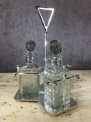 Dresser style silver plated three decanter tantalus, decanters approx 23cm in height