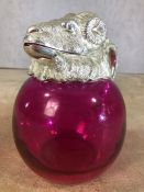 Pink glass jug with ram's head lid, approx 19cm in height