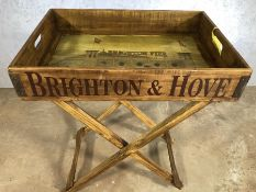 Wooden vintage style tray table stamped Brighton Pier, approx 65cm x 45cm x 80cm tall