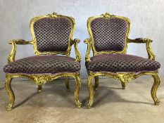 Pair of gilt framed chairs with purple upholstery