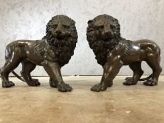 Pair of bronze lions, each approx 23cm in height