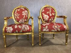 Pair of gilt framed chairs with red floral upholstery