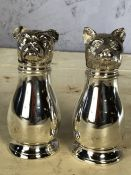 Novelty silver coloured metal dog and cat salt and pepper shakers, approx 11cm in height
