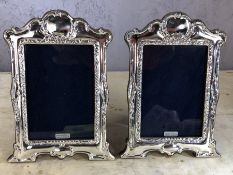 Pair of silver photo frames, approx 21cm x 15cm