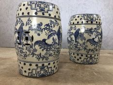 Pair of blue and white porcelain barrel seats / stools with floral and bird design, approx 43cm in