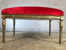 Large contemporary gilt framed upholstered stool in red fabric, approx 115cm x 60cm x 63cm tall