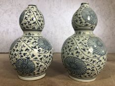 Pair of large blue and white gourd vases, each approx 39cm in height