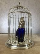 Silver plated bird cage decanter set to include parrot decanter and eight glasses. Cage approx