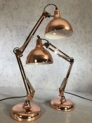 Pair of large copper coloured angle-poise lamps, each approx 70cm in height fully extended