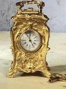 Miniature gold coloured carriage clock with key, approx 8cm in height