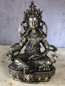Silver metal seated deity, approx 23cm in height