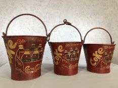 Set of three vintage style graduating metal buckets marked Coke, largest approx 29cm in height