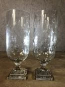 Pair of large glass hurricane lamps, each approx 40cm in height