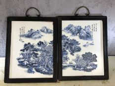Pair of framed porcelain blue and white plaques, approx 23cm x 37cm