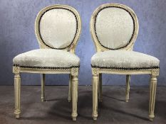 Pair of cream upholstered bedroom chairs