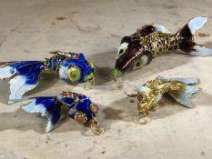 Four cloisonné decorative fish pendants, the largest approx 10cm in length