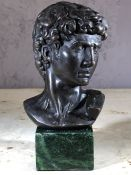 Cast metal bust of David on green marble plinth, approx 18cm in height