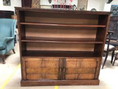 Open book case with two shelves and two cupboards under, approx 132cm x 32cm x 122cm tall