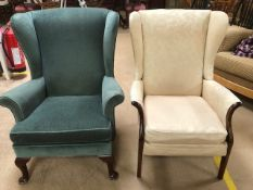 Two upholstered wing back armchairs