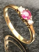 9ct Gold ring set with a single ruby and with Diamond shoulders size M