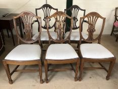 Set of five shield back dining chairs with upholstered seats and wheatsheaf design, to include two