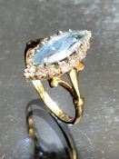 18ct Gold Marquise ring with faceted Oval pale Sapphire approx 12mm long and surrounded by