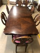 Large extendable dining room table, approx 180cm x 112cm (unextended) with eight shield back