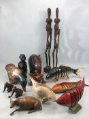 Collection of carved wooden Chinese / Eastern /Tribal items to include articulated fish, oxen,