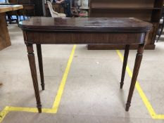 Mahogany card table with green baize on fluted legs, approx 91cm x 45cm x 74cm tall (unextended)