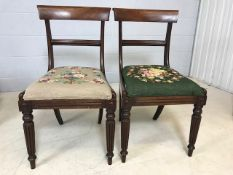 Pair of mahogany chairs with turned front legs and tapestry seats