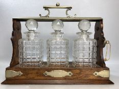 TANTALUS by DANIEL AND ARTER of Birmingham with unengraved Cartouche (some chips to decanters)